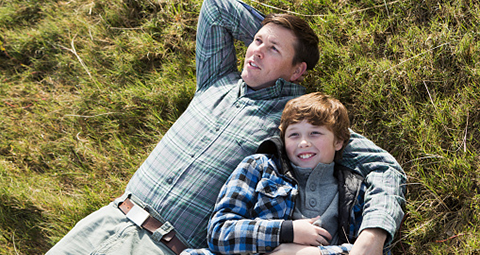 father and son staring up at sky header image